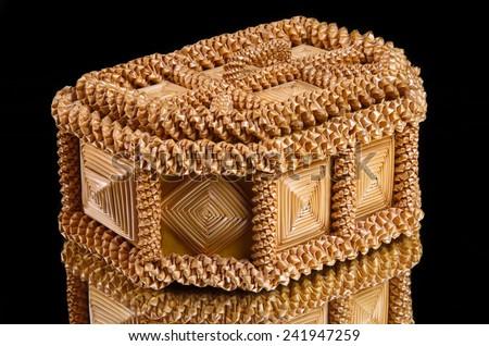 yellow jewelery box on black - stock photo