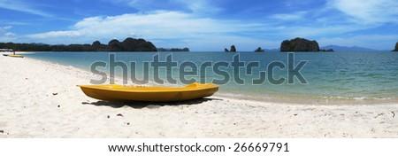 Yellow kayak on the famous Thanjung Rhu beach of Langkawi, Malaysia - stock photo