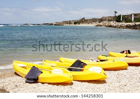 Yellow kayaks at the beach