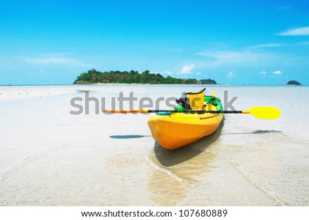 Yellow kayaks on the beach. CHANG ISLAND,THAILAND - stock photo