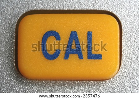 "yellow key of a pocket calculator, inscription ""CAL"""