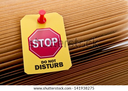 Yellow label with do not disturb image on old book sheets/Do not disturb with my reading 2 - stock photo