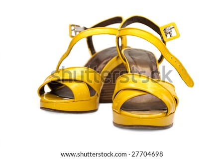 Yellow lady sandals insulated on white background
