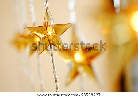yellow lamp in the form of a holiday star - stock photo
