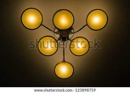 yellow lamp on the ceiling - stock photo