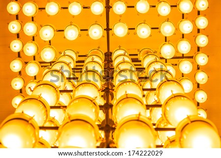 Yellow lamps on ceiling - stock photo