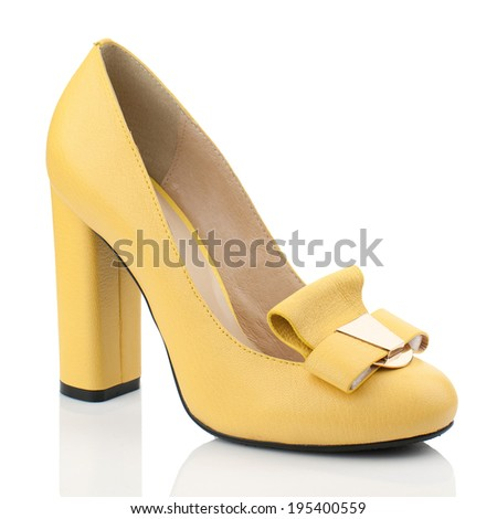 Yellow  leather  high heel women shoe isolated on white background.Please, look for more photos like this in my sets. - stock photo