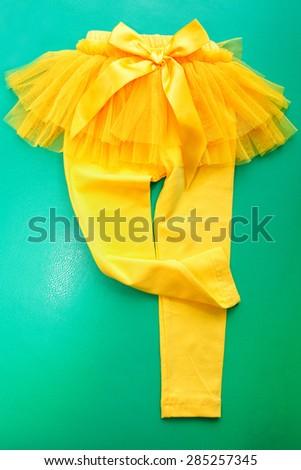 yellow leggings trousers pants  - stock photo