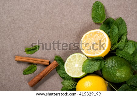 Yellow lemon, lime and green mint leaves on  table. Top view  - stock photo