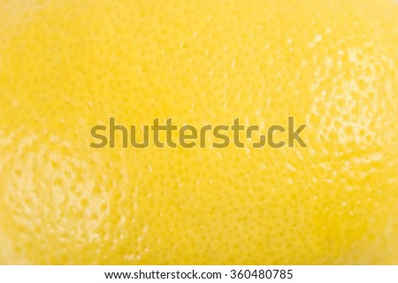 Yellow Lemon Peel Texture Macro - stock photo