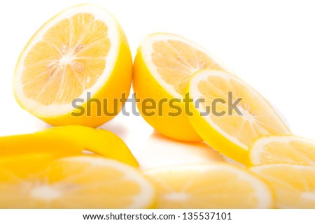 yellow Lemons and slice on a white background