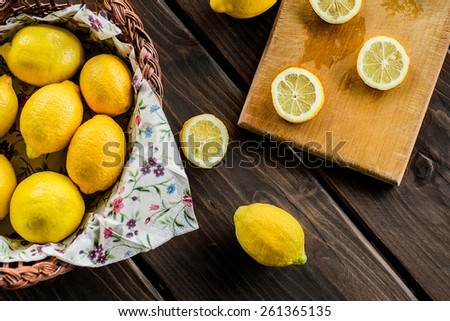 yellow lemons on the wooden table - stock photo