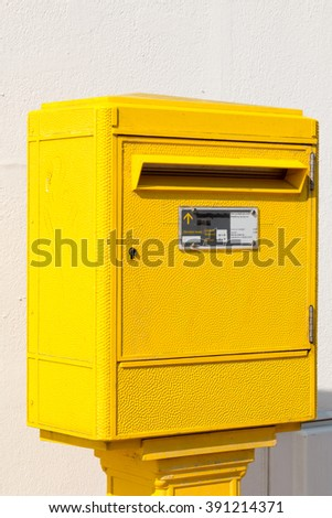 yellow letter Box in the street - stock photo