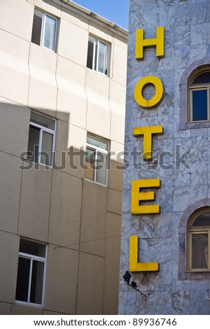 Yellow letters of hotel sign. - stock photo