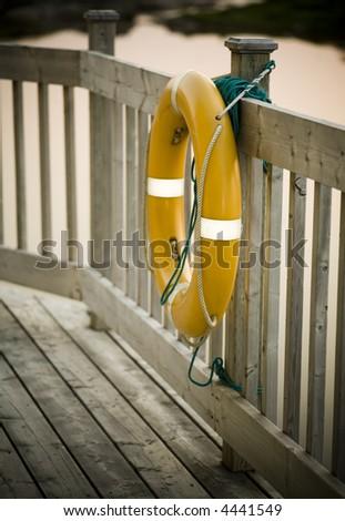 Yellow life saver tied to a bridge, Newfoundland - stock photo
