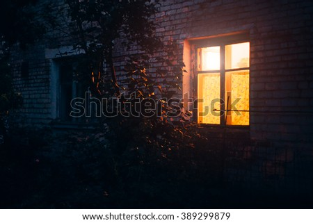 Yellow light from window late at night in the south of Russia