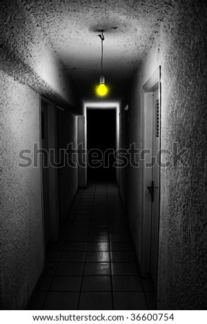 Yellow light glowing in dark underground corridor. - stock photo