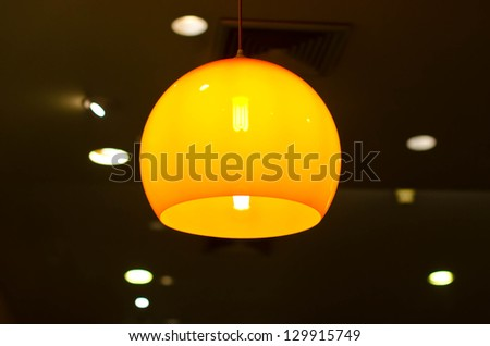 Yellow light hanging on the ceiling. - stock photo