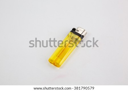 Yellow lighter on white background,isolated - stock photo