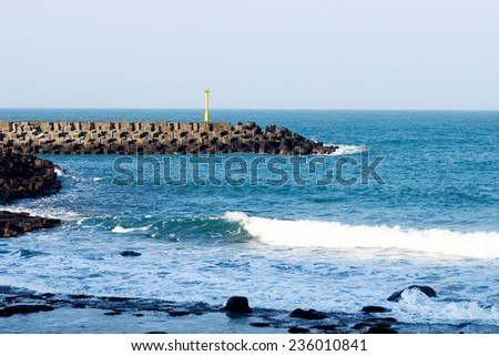 Yellow Lighthouse at harbor  - stock photo