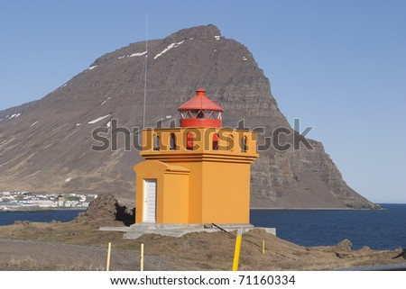 Yellow Lighthouse in Iceland - stock photo