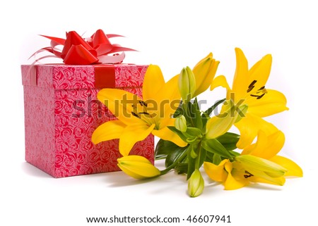 Yellow lily and gift box on a white background