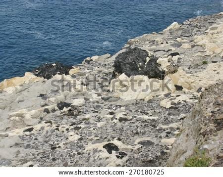 Yellow limestone rocks at the coast of Puerto de la Pena on the island Fuerteventura one of the Canary islands in the Atlantic ocean belonging to Spain - stock photo
