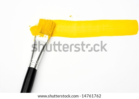 Yellow line and brush over white - stock photo