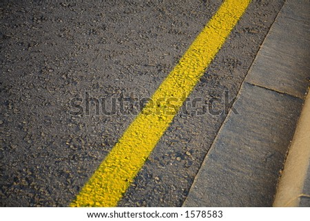 Yellow line at theside of a road. - stock photo