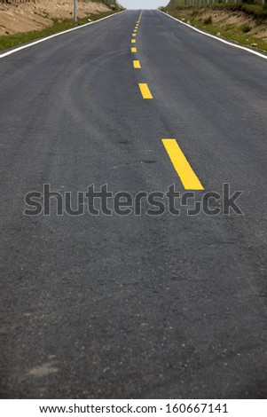 Yellow line highway - stock photo