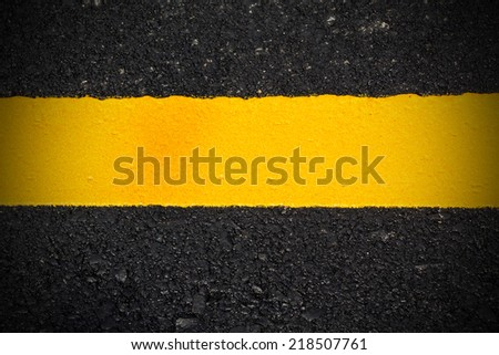 Yellow line on new asphalt road - stock photo