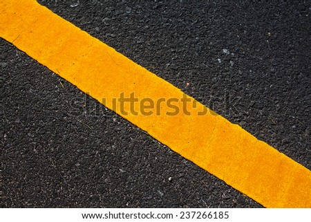 yellow line on the road texture - stock photo