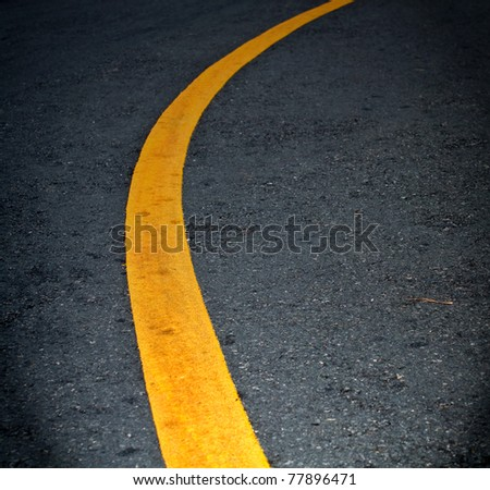 yellow lines on asphalt - stock photo