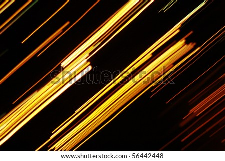 Yellow lines on black background - stock photo