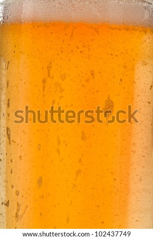 Yellow liquid drink with bubbles and foam close up macro - stock photo