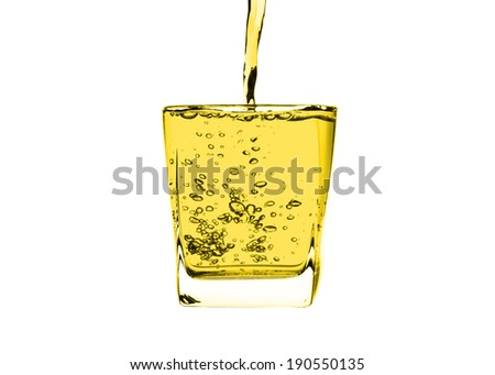 Yellow liquid splashing isolated on white background. with clipping path. - stock photo