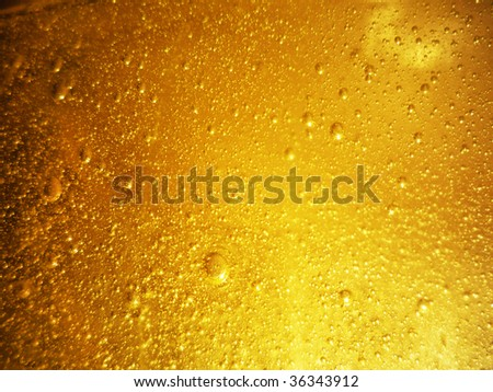 yellow liquid with bubbles and with shine - stock photo