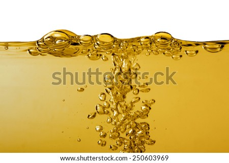 Yellow liquid with bubbles on white - stock photo