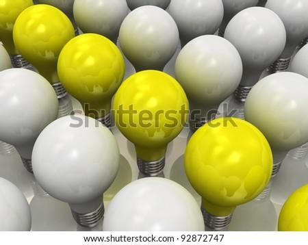 Yellow lits light bulb amongst other broken light bulbs - stock photo
