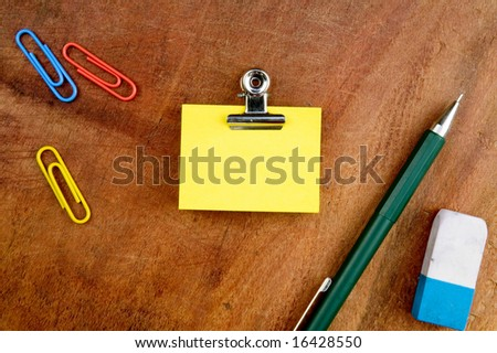 Yellow little Note Paper,Paperclip, mechanic pencil and eraser - stock photo