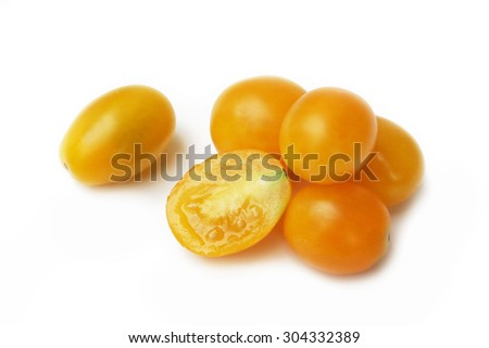 yellow little tomatoes on white background