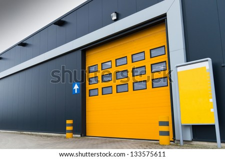 yellow loading door - stock photo