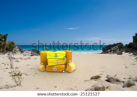 Yellow luggage on a tropical beach - stock photo