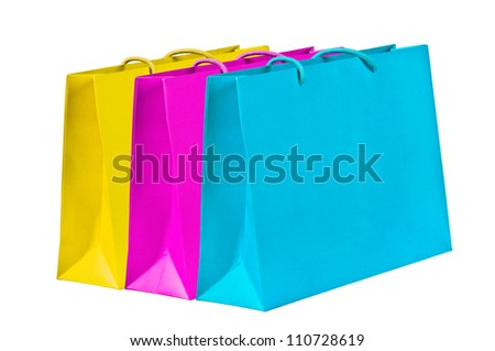 Yellow, magenta, cyan shopping bags on white.