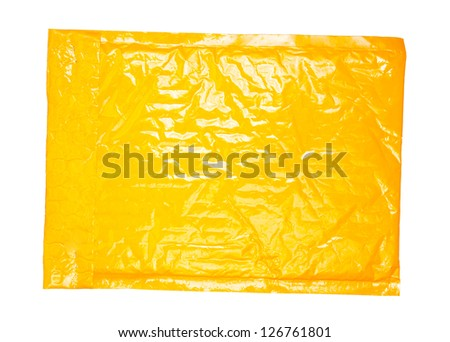 Yellow mail package, isolated on white - stock photo