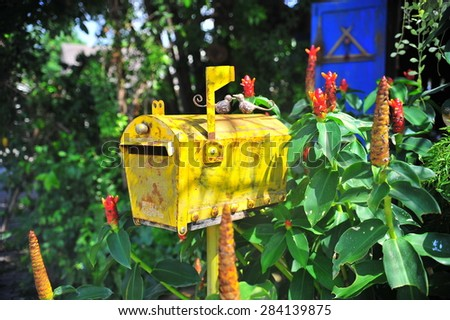 Yellow mailbox - stock photo