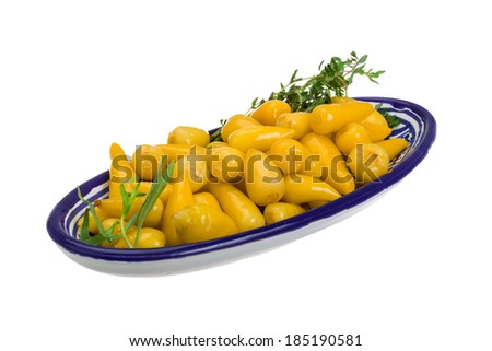 Yellow marinated pepper with thyme - stock photo