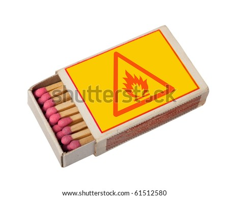 Yellow  matchbox with hazard sign isolated on white, clipping path. - stock photo