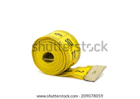 yellow measuring tape on white background - stock photo
