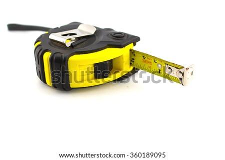 yellow measuring tape on white background. - stock photo